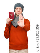 Купить «The Caucasian man with the international passport of the Russian Federation in warm clothes. Holds the opened palm before itself, the gesture - an appeal will stop», фото № 29920359, снято 10 февраля 2019 г. (c) Владимир Арсентьев / Фотобанк Лори