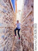 Купить «Unidentified man climbs between Genie interval at Cumalikizik village,a popular destination for Tourists and locals in Bursa,Turkey. 20 May 2018.», фото № 29928503, снято 20 мая 2018 г. (c) easy Fotostock / Фотобанк Лори