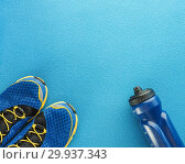 Купить «Sports equipment flat lay composition, running shoes and bottle of water on blue background. Concept healthy lifestyle, sport and diet», фото № 29937343, снято 5 февраля 2019 г. (c) Евгений Бобков / Фотобанк Лори