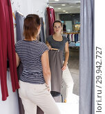 Купить «Woman trying clothes in fitting room», фото № 29942727, снято 10 октября 2018 г. (c) Яков Филимонов / Фотобанк Лори