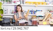 Купить «Adult woman seller working with documents», фото № 29942767, снято 7 мая 2018 г. (c) Яков Филимонов / Фотобанк Лори