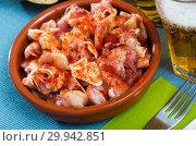 Купить «Pig ears with paprika in bowl», фото № 29942851, снято 23 марта 2019 г. (c) Яков Филимонов / Фотобанк Лори