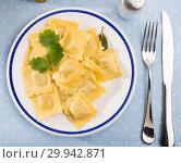Купить «Plate of freshly boiled ravioli», фото № 29942871, снято 26 марта 2019 г. (c) Яков Филимонов / Фотобанк Лори