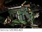 Купить «St.Petersburg, Russia - April 2018 -Printed circuit board. Computer technology background.», фото № 29943423, снято 13 апреля 2018 г. (c) Мельников Дмитрий / Фотобанк Лори