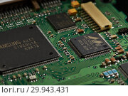 Купить «St.Petersburg, Russia - April 2018 -Printed circuit board. Computer technology background.», фото № 29943431, снято 13 апреля 2018 г. (c) Мельников Дмитрий / Фотобанк Лори