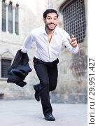 Купить «Emotional man in formalwear running», фото № 29951427, снято 5 августа 2017 г. (c) Яков Филимонов / Фотобанк Лори