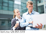 Купить «Couple professionals are examinating project on laptop», фото № 29951519, снято 15 июля 2017 г. (c) Яков Филимонов / Фотобанк Лори
