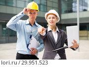 Купить «Couple architectors are estimating results of their project», фото № 29951523, снято 15 июля 2017 г. (c) Яков Филимонов / Фотобанк Лори