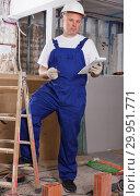 Купить «Builder planning construction works», фото № 29951771, снято 28 мая 2018 г. (c) Яков Филимонов / Фотобанк Лори