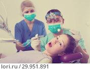 Купить «Frightened girl during dental treatment», фото № 29951891, снято 1 марта 2018 г. (c) Яков Филимонов / Фотобанк Лори