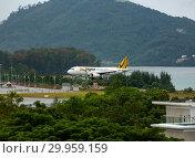 Купить «Airbus Tiger Airways landing approach», фото № 29959159, снято 29 ноября 2016 г. (c) Игорь Жоров / Фотобанк Лори