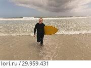 Купить «Senior woman running with surfboard on the beach», фото № 29959431, снято 6 ноября 2018 г. (c) Wavebreak Media / Фотобанк Лори