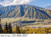 Caucasian landscape, aerial view of the town Mestia in mountain valley, Upper Svaneti, Georgia (2018 год). Стоковое фото, фотограф Юлия Бабкина / Фотобанк Лори