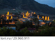 Купить «Mestia at twilight, illuminated Svan towers on the background of a mountain slope, Upper Svaneti, Georgia», фото № 29960911, снято 28 сентября 2018 г. (c) Юлия Бабкина / Фотобанк Лори