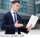 Купить «Manager is examining project on a laptop», фото № 29961299, снято 3 июня 2017 г. (c) Яков Филимонов / Фотобанк Лори