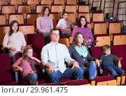 People enjoying film screening in cinema. Стоковое фото, фотограф Яков Филимонов / Фотобанк Лори