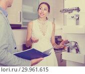 Купить «Girl consulting in search of faucet», фото № 29961615, снято 15 июня 2017 г. (c) Яков Филимонов / Фотобанк Лори