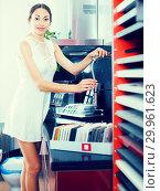 Купить «Woman choosing new stylish mixer tap», фото № 29961623, снято 15 июня 2017 г. (c) Яков Филимонов / Фотобанк Лори
