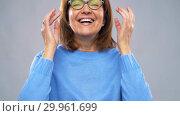 Купить «portrait of happy senior woman putting glasses on», видеоролик № 29961699, снято 13 февраля 2019 г. (c) Syda Productions / Фотобанк Лори