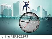 Купить «Businessman in deadline and time management concept», фото № 29962975, снято 19 марта 2019 г. (c) Elnur / Фотобанк Лори