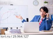 Купить «Busy businessman explaining business charts», фото № 29964127, снято 15 октября 2018 г. (c) Elnur / Фотобанк Лори