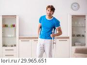 Купить «Leg injured young man with crutches at home», фото № 29965651, снято 19 сентября 2018 г. (c) Elnur / Фотобанк Лори