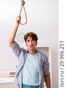 Купить «Young man preparing to commit suicide by hanging», фото № 29966251, снято 25 сентября 2018 г. (c) Elnur / Фотобанк Лори