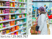 Купить «Russia, Samara, January 2019: A beautiful mature woman chooses products in the self-service store.», фото № 29969767, снято 16 января 2019 г. (c) Акиньшин Владимир / Фотобанк Лори