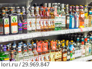 Купить «Russia, Samara, January 2019: a large selection of alcoholic beverages on the shelves of the supermarket. Text on russian: action, rum, tequila, captain», фото № 29969847, снято 22 января 2019 г. (c) Акиньшин Владимир / Фотобанк Лори