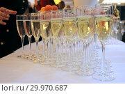 Купить «Бокалы с шампанским на праздничном столе», фото № 29970687, снято 26 декабря 2018 г. (c) Татьяна Белова / Фотобанк Лори