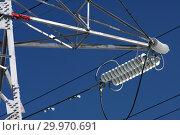 Купить «Опора ЛЭП с высоковольтными проводами на фоне голубого неба», фото № 29970691, снято 30 января 2010 г. (c) Александр Гаценко / Фотобанк Лори