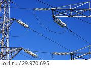 Купить «Опора ЛЭП с высоковольтными проводами на фоне голубого неба», фото № 29970695, снято 30 января 2010 г. (c) Александр Гаценко / Фотобанк Лори