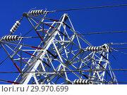 Купить «Опора ЛЭП с высоковольтными проводами на фоне голубого неба», фото № 29970699, снято 30 января 2010 г. (c) Александр Гаценко / Фотобанк Лори