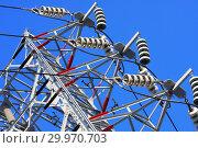 Купить «Опора ЛЭП с высоковольтными проводами на фоне голубого неба», фото № 29970703, снято 28 февраля 2010 г. (c) Александр Гаценко / Фотобанк Лори