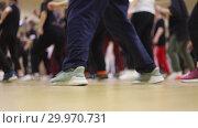Купить «A group of people dancing. Movement of the feet of dancers», видеоролик № 29970731, снято 16 февраля 2019 г. (c) Константин Шишкин / Фотобанк Лори