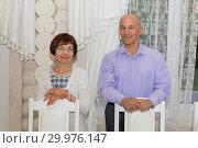 Купить «Beautiful elegant middle-aged couple posing smiling at a holiday.», фото № 29976147, снято 18 мая 2018 г. (c) Акиньшин Владимир / Фотобанк Лори