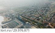 Купить «Aerial view of seaside area of Barcelona with harbor on sunny day, Catalonia, Spain», видеоролик № 29976871, снято 16 ноября 2018 г. (c) Яков Филимонов / Фотобанк Лори