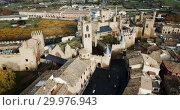 Купить «Aerial view of impressive medieval Royal Palace of Olite in autumn day, Navarre, Spain», видеоролик № 29976943, снято 20 декабря 2018 г. (c) Яков Филимонов / Фотобанк Лори