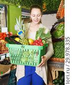 Купить «female who is holding basket in time shopping», фото № 29978335, снято 26 мая 2018 г. (c) Яков Филимонов / Фотобанк Лори