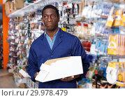 Купить «seller organizing assortment of items on shelves and racks», фото № 29978479, снято 21 января 2019 г. (c) Яков Филимонов / Фотобанк Лори
