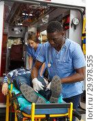 Купить «Ambulance team laying patient on stretcher», фото № 29978535, снято 30 ноября 2018 г. (c) Яков Филимонов / Фотобанк Лори