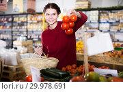 Купить «Teenager buys fresh vegetables», фото № 29978691, снято 1 марта 2017 г. (c) Яков Филимонов / Фотобанк Лори