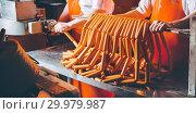 Купить «sausage meat production», фото № 29979987, снято 7 февраля 2019 г. (c) Mark Agnor / Фотобанк Лори
