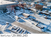 Купить «Open warehouse for storage of large diameter metal pipes. A gantry crane is installed in the territory. Winter sunny day.», фото № 29980243, снято 23 января 2019 г. (c) Андрей Радченко / Фотобанк Лори