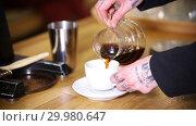Купить «Barista making coffee. Barista pouring an americano in the cup», видеоролик № 29980647, снято 18 февраля 2019 г. (c) Константин Шишкин / Фотобанк Лори