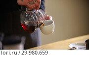 Купить «Barista making tea. Pouring the tea in the cup», видеоролик № 29980659, снято 18 февраля 2019 г. (c) Константин Шишкин / Фотобанк Лори