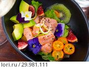 Купить «Ceviche of salmon with kiwi fruit, avocado, kumquat, figs», фото № 29981111, снято 21 ноября 2019 г. (c) Яков Филимонов / Фотобанк Лори