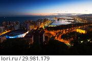 Купить «Malaga with Port from castle in twilight time. Spain», фото № 29981179, снято 4 декабря 2014 г. (c) Яков Филимонов / Фотобанк Лори