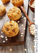 Купить «Diet oat muffins with raisins», фото № 29981307, снято 4 апреля 2018 г. (c) Надежда Мишкова / Фотобанк Лори