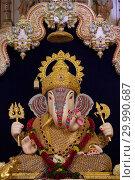 Купить «Dagdusheth Halwai Ganpati idol, Pune, Maharashtra, India.», фото № 29990687, снято 30 августа 2017 г. (c) age Fotostock / Фотобанк Лори